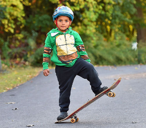 Young Skateboarder at East Woods Skate Plaza