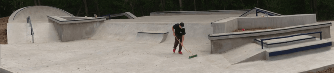 One of the Skateboarders cleaning the new plaza
